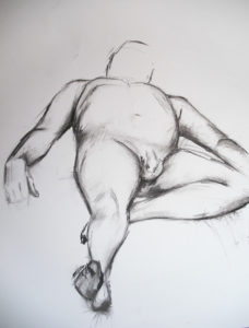 Life drawing model in reclined pose