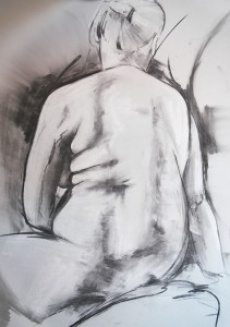 Life drawing model in seated pose